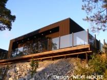Maison avec bardage bois et terrasse bois